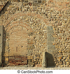 old stone and brick wall with arcs, place where Niccolo' Machiavelli was writing his works,San Casciano in Val di Pesa,Tuscany, Italy, Europe