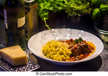 "osso buco - plate with ""osso buco"" with some wine, cheese..."