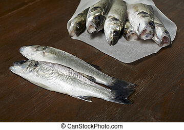 fresh fish, sea bass, ready for cooking