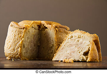 Melton Mowbray pork pie cut low shot - An English artisan...