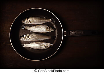 Vintage style photo, fresh fish, sea bass, ready for cooking