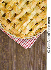 Lattice pastry apple pie top, cooked with copy space -...