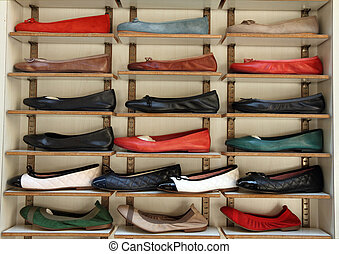 leather ballerina shoes display on italian market