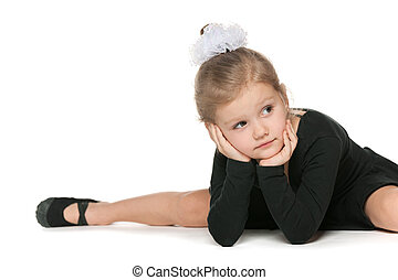 Little dancer - Young ballet dancer is having some rest...