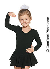 Dancing little girl - A portrait of a dancing little girl on...