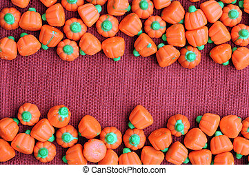 pumpkin sharp Halloween candies on red burlap