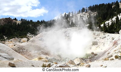 Bumpass Hell Fumaroles - Sulfur fumes rise from a fumarole...