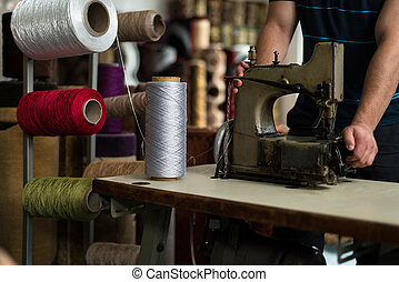 Carpet Designer With Sewing Machine - Young Man Carpet Maker...