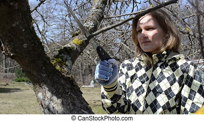 gardener woman cut twig - happpy gardener woman first spring...