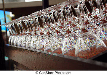 Glasses - Cups are seen lined up in a bar in Qingdao city,...