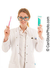 Dentist with brush and tooth paste - Female dentist with...