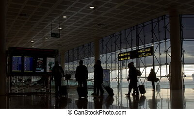 airport hurry - people rushing at the airport of barcelona