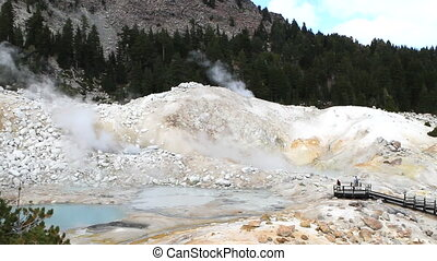 Bumpass Hell - Geothermal vapor from mudpots, boiling...