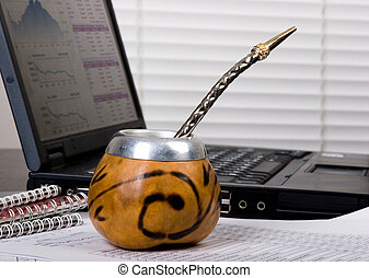 mate break - calabash of mate at the office table near the...