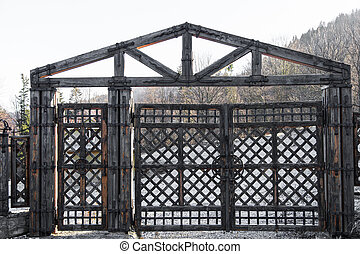 Old wooden gate with wrought iron elements in winter