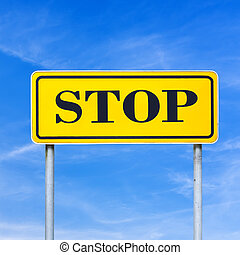 Stop - Word Stop written on yellow road sign.