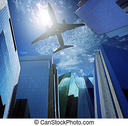 passenger plane flying over modern office building against...