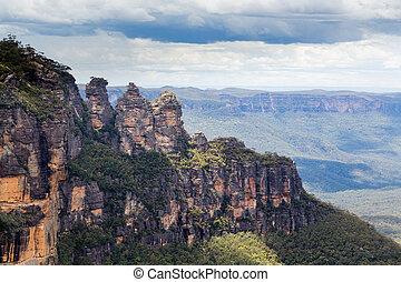 Three Sisters in Blue Mountains Australia - Sun illuminates...