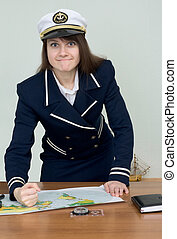 Woman in a sea uniform at table with map