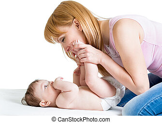 happy mother having fun with her baby boy infant