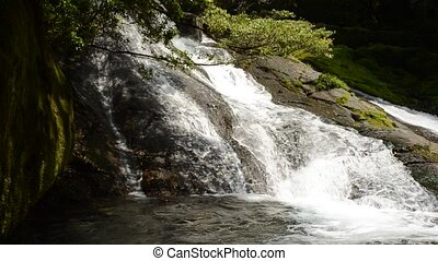 Waterfall on a rocky slope - Waterfall which flows down a...