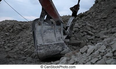 Heavy mining dump truck being loade