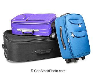 Three Suitcases - Three full and closed suitcases, black,...