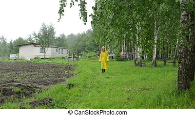 birch branch woman house - Cheerful woman in waterproof coat...