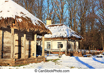 Rural houses - Rustic wooden log hut with a straw roof in a...