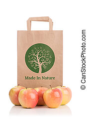 Paper bag with apples isolated on white background. Bio...