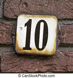 Number 10 - Enameled house number ten. Black lettering on a...