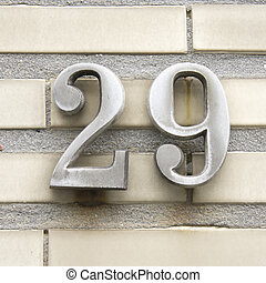 Number 29 - metal house number twenty nine on a wall of...