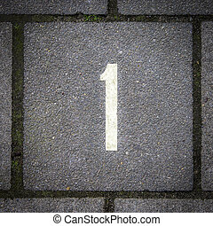 Number 1 - Number one on colored pavement tiles.