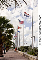 International Flags Along Walk - A seaside walkway with...