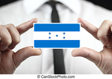 Businessman holding a business card with Honduras Flag