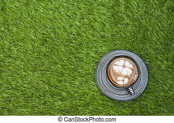 Coffee put on grass field