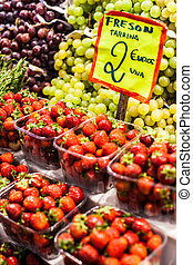 Fresh, red Strawberries at a local farmers market in...
