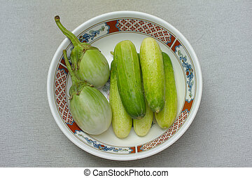cucumber and brinjal - Five cucumber and two brinjal eat wit...