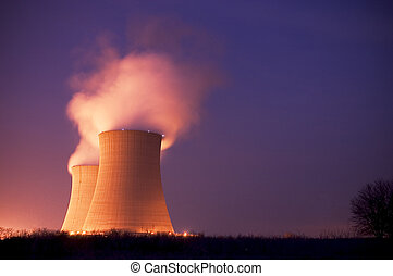 Nuclear Power Plant Cooling Towers at with stream pouring...