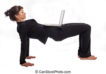 Woman doing Yoga at Work. - Multi tasking woman in yoga...