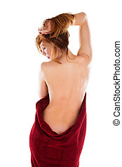 Young nude woman with red towel on white - Young nude woman...