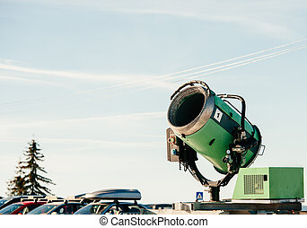 Snow cannon in parking - Snow cannon (snow maker) on a...