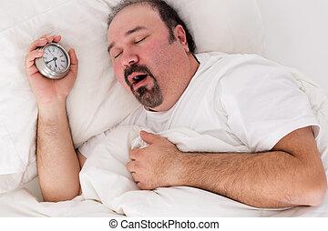 Lethargic man yawning as he struggles to wake up - Lethargic...