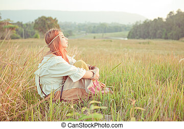 Hippie girl at golden field - Country hippie girl sitting at...