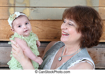 Grandmother and Grandaughter - Grandmother with a three...