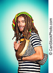 tom-tom music - Portrait of a rastafarian guy playing his...