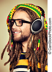 smile reggae - Portrait of a happy rastafarian young man...