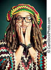 funny emotion - Portrait of a happy rastafarian young man...