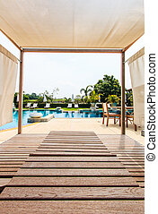 Sunbeds chair and swimming pool