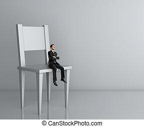 man sitting a big chair